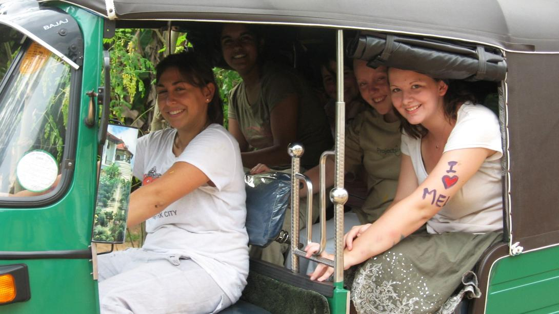 High School students explore Sri Lanka in the back of a tuk tuk.